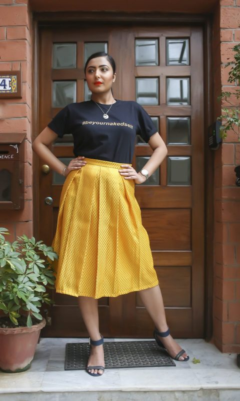 Yellow pleated midi skirt