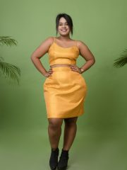 Mustard yellow brocade crop top worn with mustard brocade tube skirt