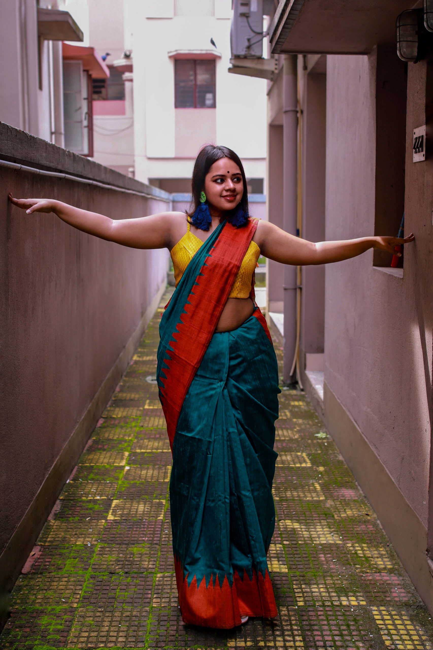 Wear it with a bright contrasting saree