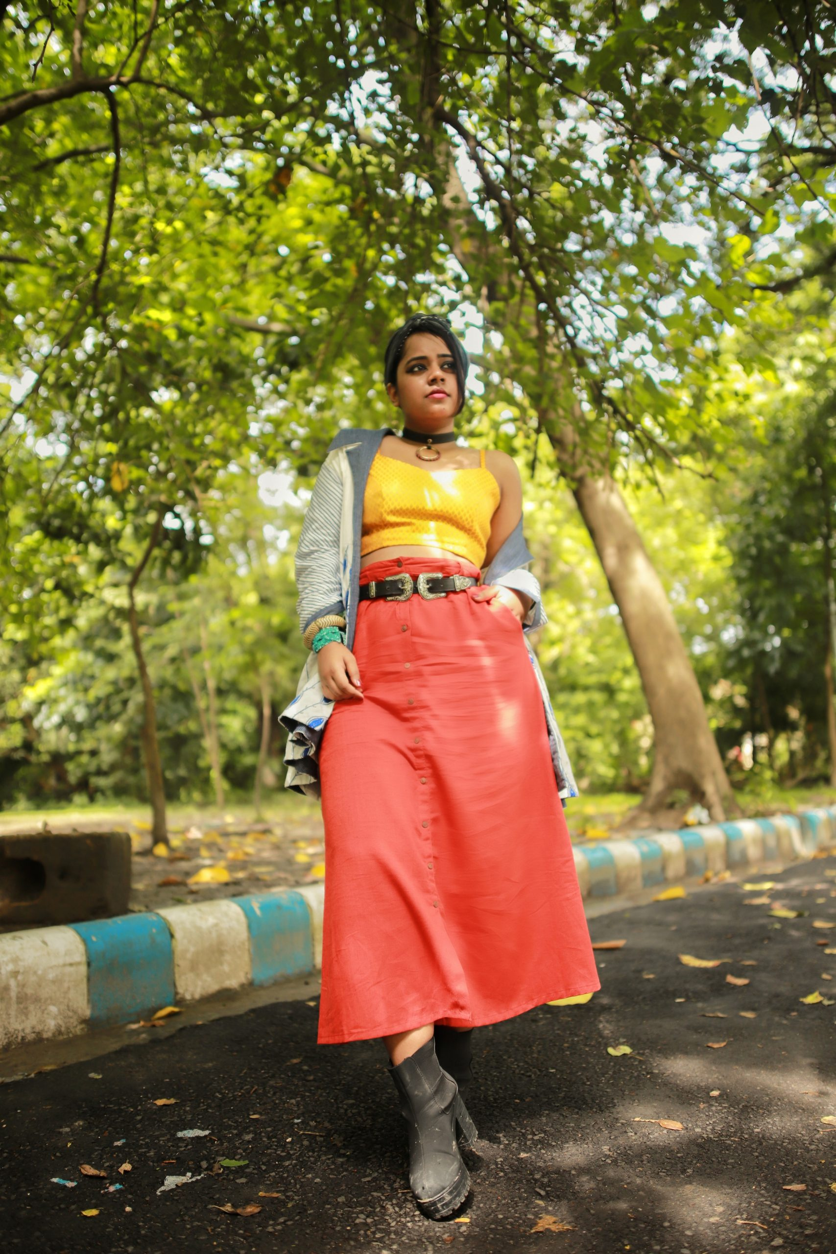 The brocade tops with a belted long skirt looks chic and smart