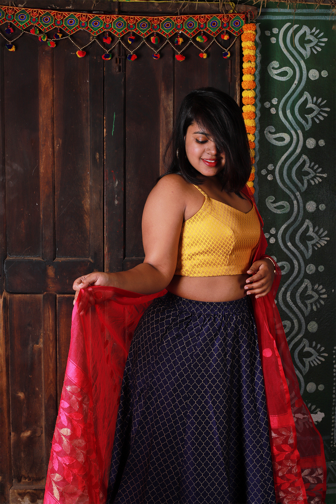 Mustard brocade crop top with a long skirt and a beautiful dupatta makes for a fantastic festive outfit