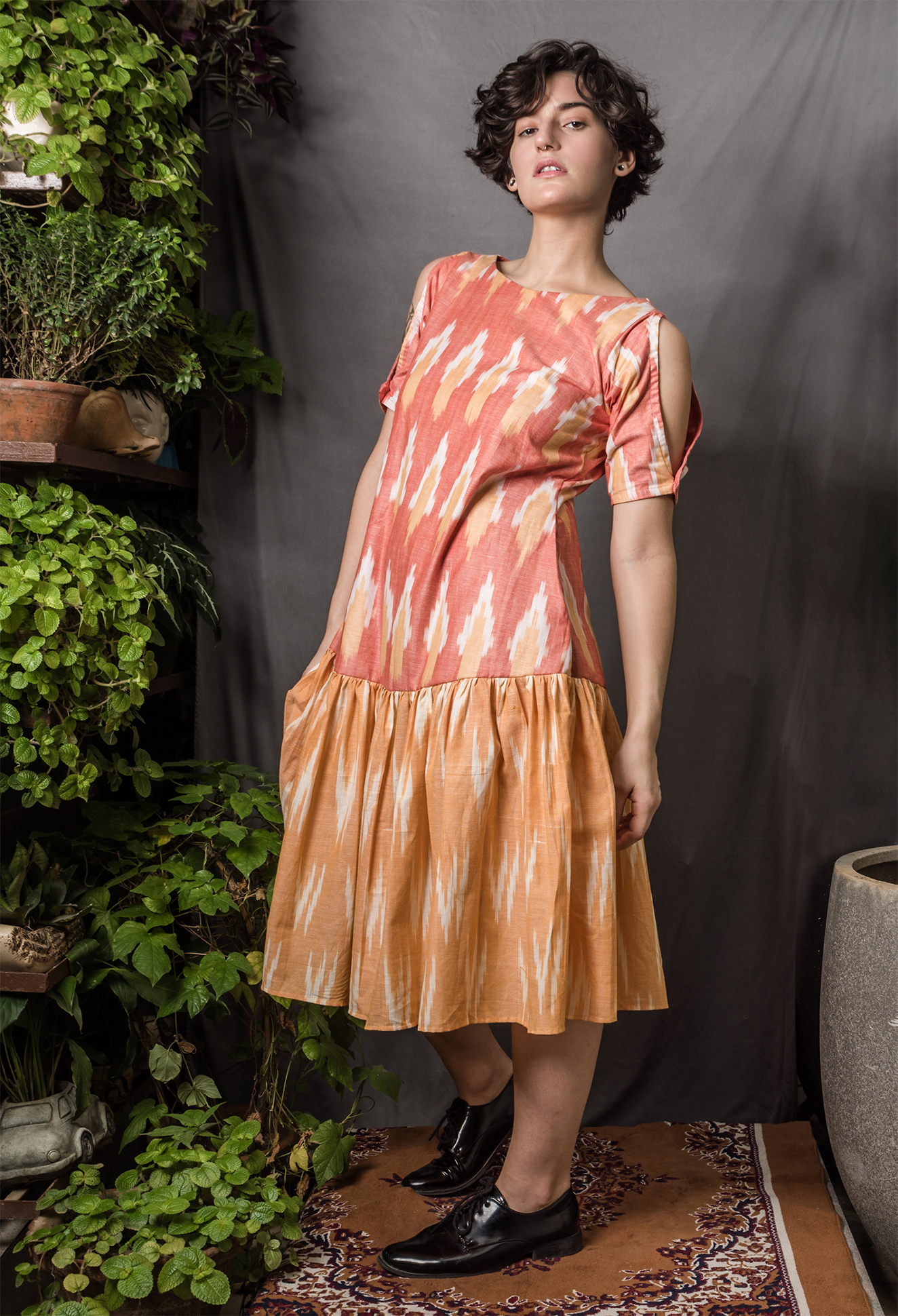 Drop waist Ikat dress with a peek-a-boo sleeve