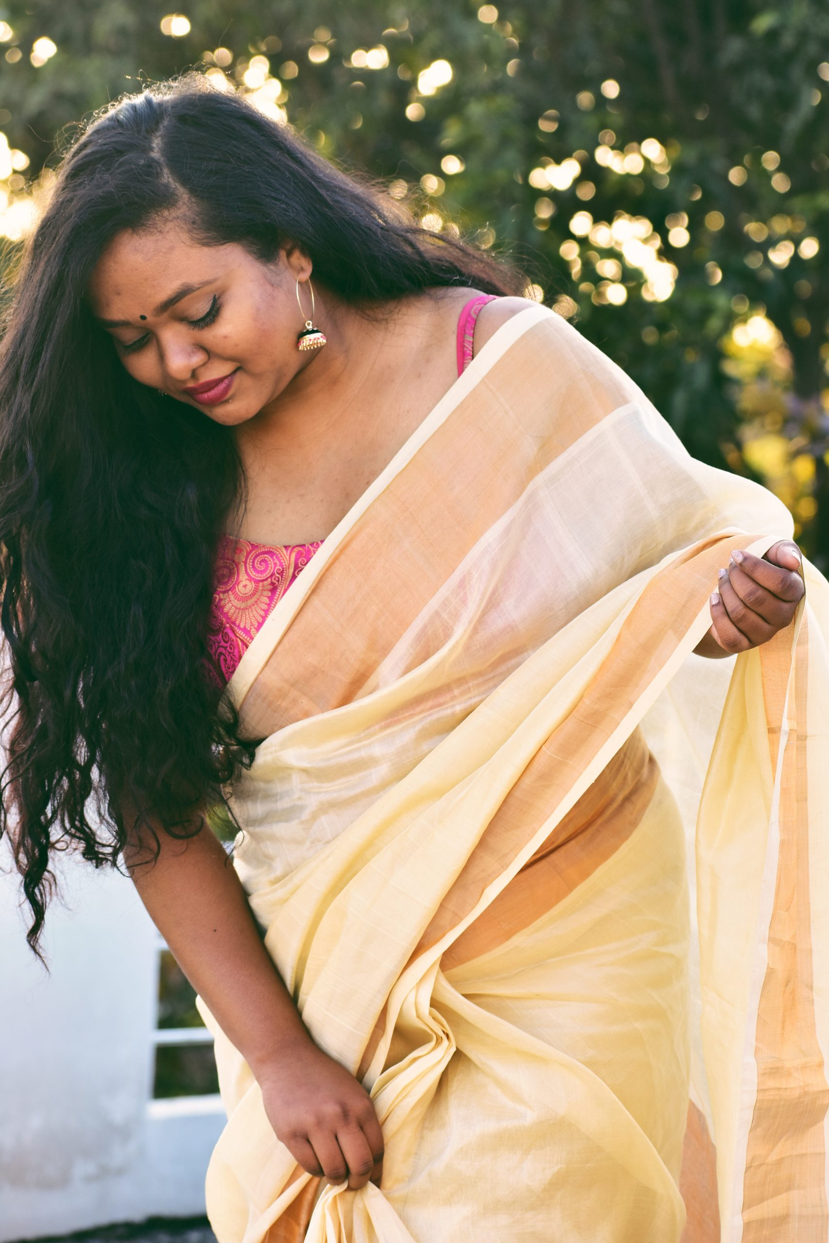 Our pink brocade top looks great with a cream linen saree